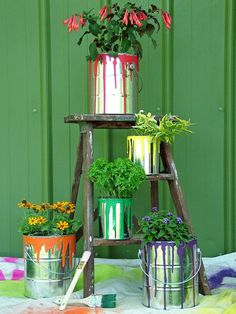 Upcycled Container Gardens, Planters and Vases: Recycle old paint cans or buy metal paint cans at hardware stores and home centers. To dress them up, drizzle craft paint around the top rim and add some drips down the sides. Cover with a coat of polyurethane to stop the cans from rusting, or leave them untreated and enjoy the rusty, rustic look that develops within a few months. Design by Nancy Ondra From DIYnetwork.com