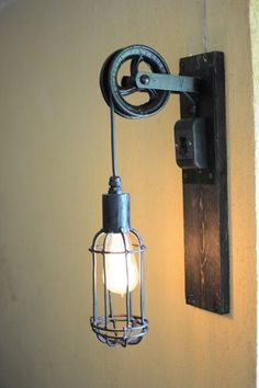 Pulley decor – Eclectic Home Decor Today Rustic Lamps, Rustic Lighting, Industrial Lighting, Lighting Design, Pulley Light, Style Deco, Steampunk Lamp, Led Licht, Wooden Lamp