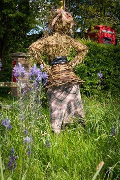 Scarecrow -Wicker Woman with hands on hips,perhaps impatient to use telly to her left? (UK)