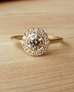 Bezel Set Diamond Halo Ring by kateszabone on Etsy https://www.etsy.com/listing/88492124/bezel-set-diamond-halo-ring