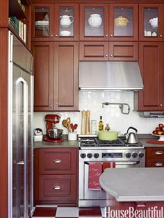 Home Depot designer Emily O'Keefe added stacked cabinetry with period charm to this small kitchen.