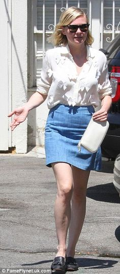 Casual cool: She rocked a white blouse with bows all over it tucked into a denim mini skir...
