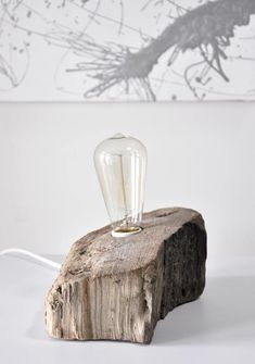 A driftwood lamp, made from found wood at the beach and an edison light bulb.