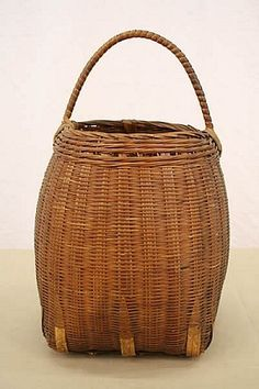 Woven Beehive  shaped Basket.  Great handmade reed basket in the classic beehive shape with a square reinforced bottom.  Very well made and hard to find in this great shape primitive piece.
