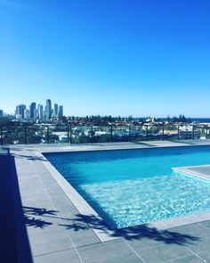 Beautiful rooftop pool completed with our Ash Grey Granite! Thanks for sharing Pool Pavers, Pool Tiles, Rooftop Pool, Outdoor Pool, Pool Coping, Pool Fashion, Pool Construction, Backyard Pool Designs, Pool Builders