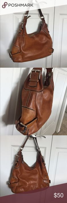 Michael kors leather handbag 🔥🔥FINAL PRICE REDUCTION🔥🔥Purchased a few years ago and moderately used, but the condition of the bag is still good. The leather under the shoulder strap is worn out, the buckles are scratched/faded, and there's one strain on the back corner. Inside has some dirt and staining by the zipper. Price is marked to reflect the wear and tear. Michael Kors Bags