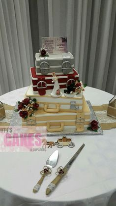Stacked suitcase wedding Cake all set up at the hall ready and waiting