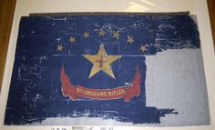 "The flag pictured here is in the Missouri State Museum's collection. It represents Beauregard's Rifles, C.S.A. And that's all the state museum staff knows about the flag. Their reserach has shown that most regiments known to be called ""Beauregard's Rifles"" orginated in Virginia. They asked us to ask you to help them: What unit was this really from? And how did it get to Missouri?"