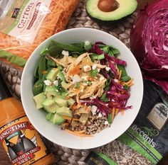 Buffalo Chicken Quinoa Bowl- I love this bowl because it is layered with grains, greens, and vegetables. Make in the Instant Pot or Slow Cooker. Made with buffalo sauce, avocado, purple cabbage, green onion, quinoa, shredded chicken, spinach, carrots and celery.