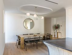 BB.03.14 in brushed brass with white globesDesign by DDG PartnersPhoto by Lauren Coleman