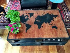 My world map stencil turned out great! Stenciled into a pallet coffee table to make a one of a kind industrial style table, on cool metal castors