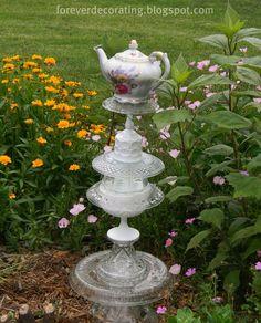 Садовая скульптура с чайником