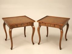 Outstanding pair of vintage Baker Furniture Company's rendition of Country French style. Well folks, they pulled it off in such a way that if you didn't see their tag in the drawer you'd never know. Gallery edges, banded burled tops, cabriolet legs and peg accents give these remarkable tables the style and character to easily mix with most any other timeless style of furnishings.