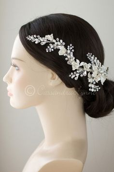 This enchanting bridal headpiece is a vine of hand-painted porcelain bisque flowers and leaves, sprays of freshwater ivory pearls, rhinestones and pear cut rhin