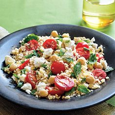 Couscous Salad with Chickpeas by Cooking Light. This main-dish grain salad recipe is ready in 20 minutes and contains whole wheat couscous, chickpeas, tomato, and feta cheese. Couscous Salad With Chickpeas, Couscous Salat, Chickpea Salad, Quinoa, Chickpea Recipes, Vegetarian Recipes, Cooking Recipes, Healthy Recipes, Main Dish Salads