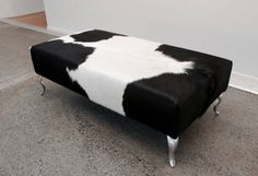 Black and White cowhide ottoman from Gorgeous Creatures with aluminium Queen Anne legs. 120cm x 60cm x 38cm in size. www.gorgeouscreatures.co.nz