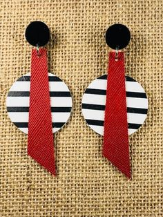 Black and white striped leather earrings with red Boho   Etsy   A pair of black and white striped earrings with a red leather running through it. I have used a black acrylic stud with them.