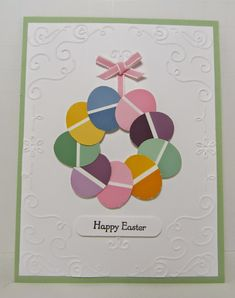 Oval punch + paint chips = darling Easter Egg wreath! Delicate swirl embossing on the corners creates a great frame on this handmade Easter card.