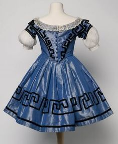 Silk dress with velvet Greek key pattern trim, 1855. This was worn by a girl aged about four years.    From The Museum of Childhood, Bethnal Green, London