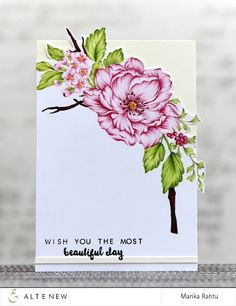 Marika's card features the set called Beautiful Day. This set has fun multilayered flowers but it also has the outline versions of the flowers and she went for the outline ones and coloured them with copics and coloured pencils.