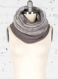 Mannequin wearing handmade cozy and warm alpaca basic knit cowl in ash and white from DeNada's Autumn and Winter 2016 collection. This gray and white circle scarf is designed in Washington, DC and hand-knit in Peru with a soft alpaca blend yarn. Photo by Emma McAlary.