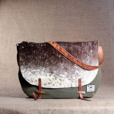 LOVE this.  a pretty simple style of bag, but mixing animal print leather with canvas.  Its an everyday bag but still really bold.