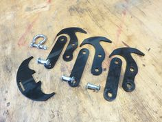 """A complete assembly includes 3 links, 3 """"hammers"""", a cross hook, and hardware. (Delrin prototype)"""
