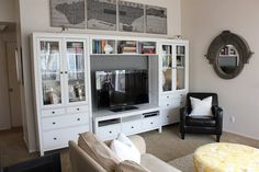 Love the glass-front cabinets and drawers in this entertainment center set up. So handy!