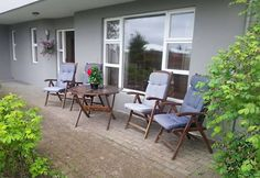 House in Reykjavík, Iceland. Lower level apartment in a duplex house. One bedroom with double bed, one bedroom with two new single beds, bathroom, kitchen and living/dining room. Parking space for two cars. Located in a calm, family friendly area. Very comfortable for a famil...