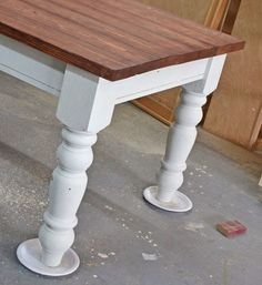paper plates under table legs when painting