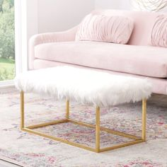 This fun trendy faux fur ottoman adds a cozy touch to any room in your home. Place this beautiful piece at the foot of the bed or add to a seating group for a punch of Hollywood glam. Color: White.