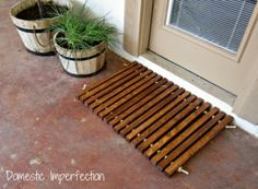 zelfgemaakte deurmat uit hout