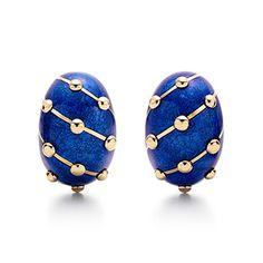 Tiffany. Schlumberger Banana earrings in 18k gold with blue enamel.