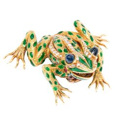 Lively Gold, Diamond, Sapphire and Enamel Frog Clip brooch - Wonderfully Detailed 18K Yellow Gold Frog Clip Brooch, set with 1 Carat Single cut Diamonds, Cabachon Sapphire Eyes, Rubies and Green Enamel. Exceptional Detail.