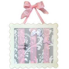 Adorable bow and barrette holder for a little girl's room.