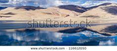 Tso Moriri (Tsomoriri) mountain lake panorama with mountains and blue sky reflections in the lake (north India)