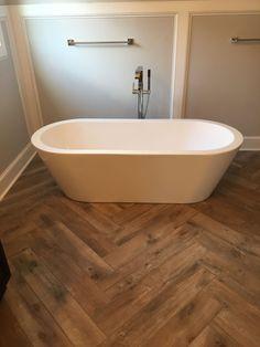 39 ideas for faux wood tile bedroom Wood Look Tile Bathroom, Chevron Bathroom, Wood Look Tile Floor, Faux Wood Tiles, Herringbone Tile Floors, Wood Tile Floors, Bathroom Flooring, Herringbone Pattern, Tile Bedroom