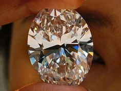 A 118.28-carat white diamond sold in Hong Kong, Oct. 7, 2013, for about $30.6 million,the most paid for a white diamond. It is the biggest diamond ever sold at auction. The previous record price for a white diamond was $26.7 million. The largest D-color flawless type IIA diamond was mined in South Africa in 2011. Sotheby's didn't disclose the buyer and seller. (Vincent Yu/AP Photo)