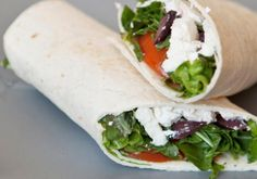 A recipe for a healthy vegetarian sandwich wrap, inspired by the flavors of Greek cooking, including feta cheese, and wrapped up in a whole wheat flour tortilla. This Greek vegetarian sandwich wrap recipe makes a great lunch or snack. Vegetarian Wraps, Healthy Wraps, Yummy Wraps, Healthy Snacks, Vegetarian Recipes, Healthy Recipes, Vegetarian Sandwiches, Wrap Recipes, Lunch Recipes
