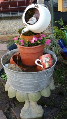 Garden teapot water fountain. Made with objects found around the house.