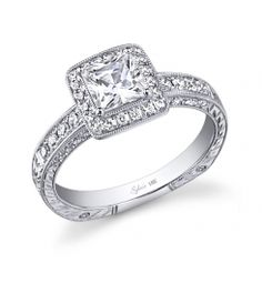 18K white gold diamond engagement ring features a 1 carat princess center diamond. The setting contains a total 0.34 carats. The diamond engagement ring is available in any shape or size center diamond, in 14K or 18K white, yellow or rose gold or platinum. (For pricing please contact Swalstead Jewelers at 407-843-6493)