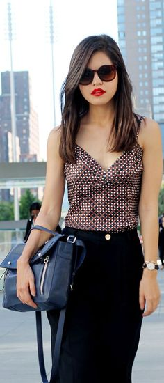 Cute v-neck top with a black skirt and colorful bag. Office chic!