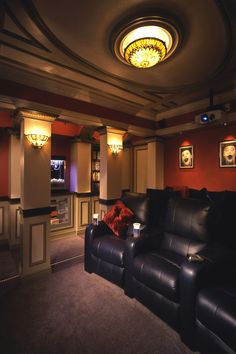 Custom Home Theater with custom ceilings and architecture displays designed by Jordan Rosenberg Architect and Associates