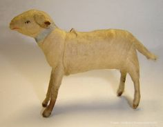 Lovely antique spun cotton Lamb Christmas ornament. The Lamb has applied Ears and a light blue silk collar around the neck.  1890-1900.  www.christmas.li