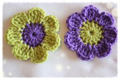 4 Hand crocheted purple and green 7 petal flowers.