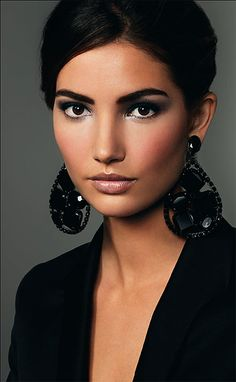 Love the makeup!  The play with dark eyes and brows and lighter lips is gorgeous.