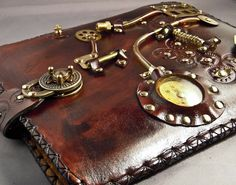 Steampunk iPad Case. I love it.... but need the iPad to go with it. Still, I'm sure the idea can be carried over