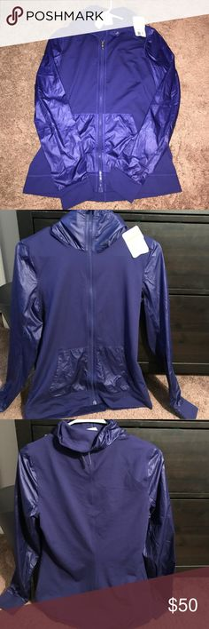 under armour compression zip up dark blue zip up. the body section is a stretchy material and the arms and pockets have a sheer type material. received this as a gift and it's not my style so i'm selling it ! any questions, just ask! Under Armour Tops Sweatshirts & Hoodies