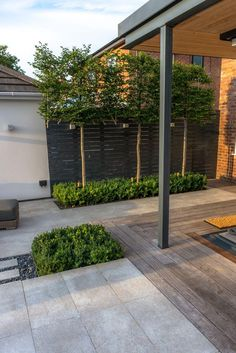 Hornbeam Designed by Robert Hughes Garden Design. A Contemporary landscape in ManchesterDesigned by Robert Hughes Garden Design. A Contemporary landscape in Manchester Hornbeam Designed by Robert Hughes Garden Design. A Contemporary landscape in Manc Contemporary Garden Design, Contemporary Landscape, Landscape Design, Modern Design, Contemporary Houses, Modern Garden Design, Backyard Patio, Backyard Landscaping, Landscaping Ideas