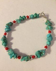 Turquoise Chips with Silver Beads and Red Seed Beads.